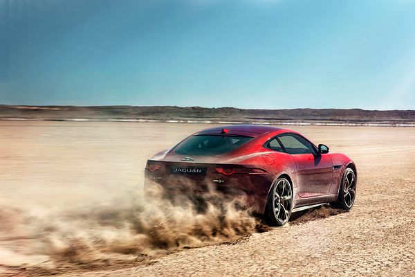 A F-Type speeding along in the desert
