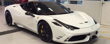 Ferrari 458 Speciale with carbon front intake ribs, canards, front spoiler, mirrors, side fins and darkened lights